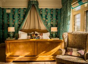 A bed or beds in a room at Fischers Baslow Hall - Chatsworth