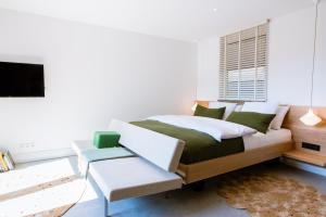 A bed or beds in a room at LoftNes