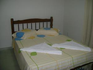 Cama ou camas em um quarto em Casa Portal 53