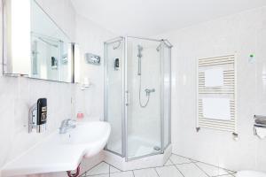 Ein Badezimmer in der Unterkunft Hotel Servatius