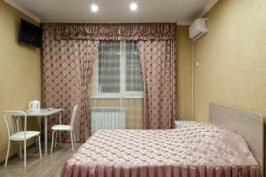 Кровать или кровати в номере Guest House on Partizanskaya