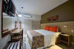 Cama ou camas em um quarto em Littoral Hotel