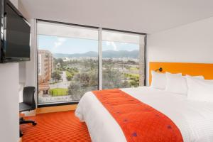 A bed or beds in a room at TRYP By Wyndham Bogota Embajada