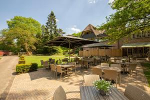 A restaurant or other place to eat at Fletcher Hotel Restaurant De Wipselberg-Veluwe