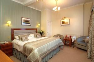 A bed or beds in a room at The George Hotel, Sure Hotel Collection by Best Western
