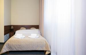 Łóżko lub łóżka w pokoju w obiekcie Arka Kraków