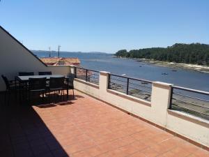 Un balcón o terraza de Apto. con terraza y vistas al mar