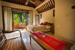 A seating area at Bali Asli Lodge by EPS