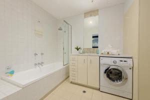 A bathroom at Treasury on Collins Apartment Hotel