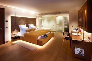 A bed or beds in a room at BEYOND by Geisel