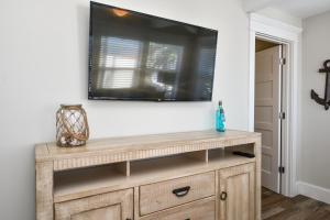 A television and/or entertainment center at Tropical Breeze Resort