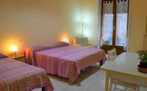 A bed or beds in a room at Sapore di Mare