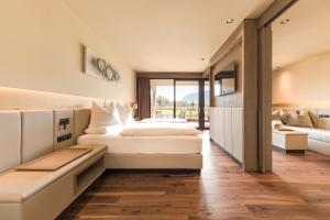 A bed or beds in a room at Weinegg Wellviva Resort
