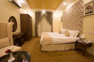Cama ou camas em um quarto em Gheras Aparthotel