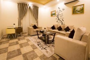 Uma área de estar em Gheras Aparthotel