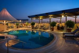 The swimming pool at or near Grand Excelsior Hotel Deira