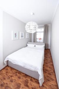 A bed or beds in a room at Central Sauna & Loft Apartments