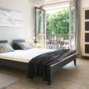 Łóżko lub łóżka w pokoju w obiekcie Apartamenty Nadmorska