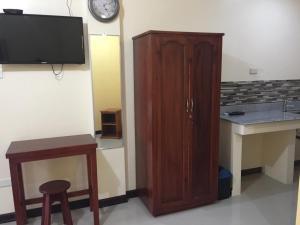 Телевизор и/или развлекательный центр в Golden Pension House,Palawan