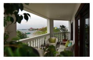 """A balcony or terrace at Fragrant Nature Kochi - """"A Classified Five Star Hotel"""""""
