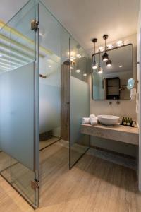 A bathroom at Poseidon Hotel Suites