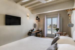A television and/or entertainment centre at Poseidon Hotel Suites