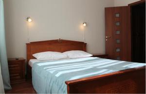 Кровать или кровати в номере Voyage-Butovo