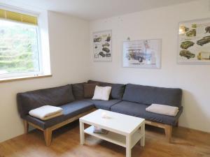 Ein Sitzbereich in der Unterkunft Downstairs6b