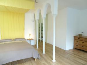 Ein Bett oder Betten in einem Zimmer der Unterkunft Downstairs6b