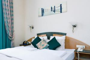Ein Bett oder Betten in einem Zimmer der Unterkunft Hotel Moby Dick by WP hotels