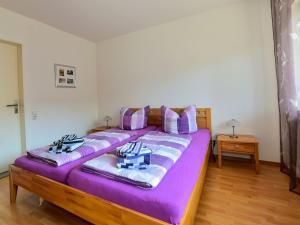 Ein Bett oder Betten in einem Zimmer der Unterkunft Ferienwohnung Schliestädt-Görge