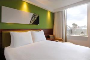 A bed or beds in a room at Hampton by Hilton Newcastle