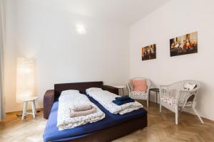 Ein Bett oder Betten in einem Zimmer der Unterkunft Quiet And Cosy Family Apartment