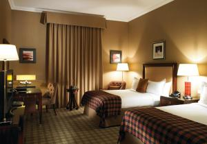 A bed or beds in a room at Fairmont St Andrews, Scotland