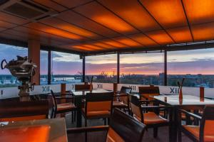 A restaurant or other place to eat at Amberton Hotel Klaipeda