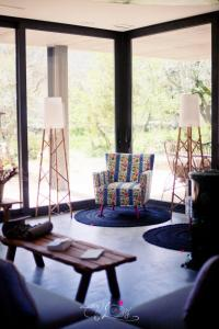 A seating area at Cooking and Nature - Emotional Hotel