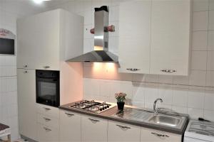 A kitchen or kitchenette at Sapore di Mare