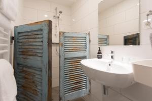 Een badkamer bij HOTELdeBEAUTEL