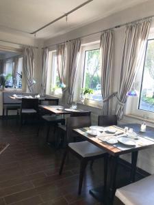 Ein Restaurant oder anderes Speiselokal in der Unterkunft Am Schleieck