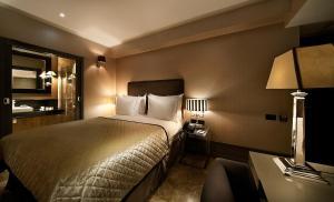 Een bed of bedden in een kamer bij Hotel B Berdichevsky