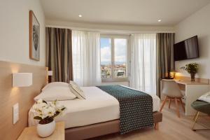 Un ou plusieurs lits dans un hébergement de l'établissement Hotel Suisse