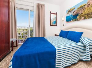 Een bed of bedden in een kamer bij Globales Condes de Alcudia