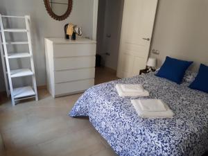 Cama o camas de una habitación en Apartamento Anibal González