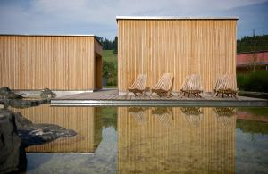 The swimming pool at or near Tannenhof Sport & SPA
