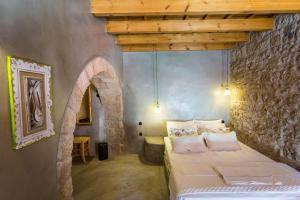 Un ou plusieurs lits dans un hébergement de l'établissement Rodi