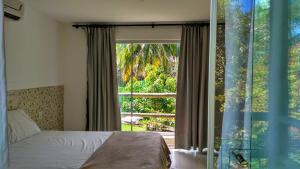 Cama ou camas em um quarto em Chalé coco b4