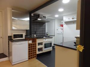 A kitchen or kitchenette at Ponto de Vista - Coimbra