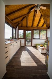 A kitchen or kitchenette at Poseydon Beach Bungalow