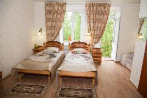 Кровать или кровати в номере Отель Виктория