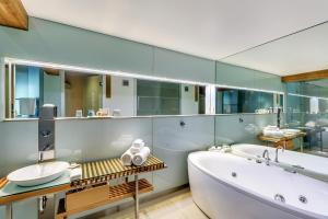 A bathroom at The Henry Jones Art Hotel